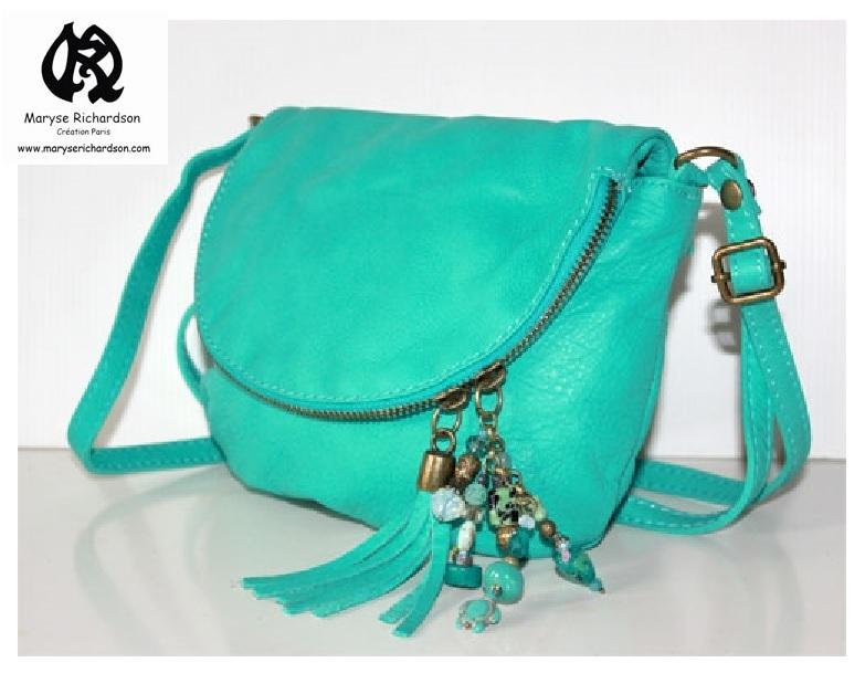 52681f8d85 sac à main modèle mini besace en cuir lisse tons turquoise et bronze ...